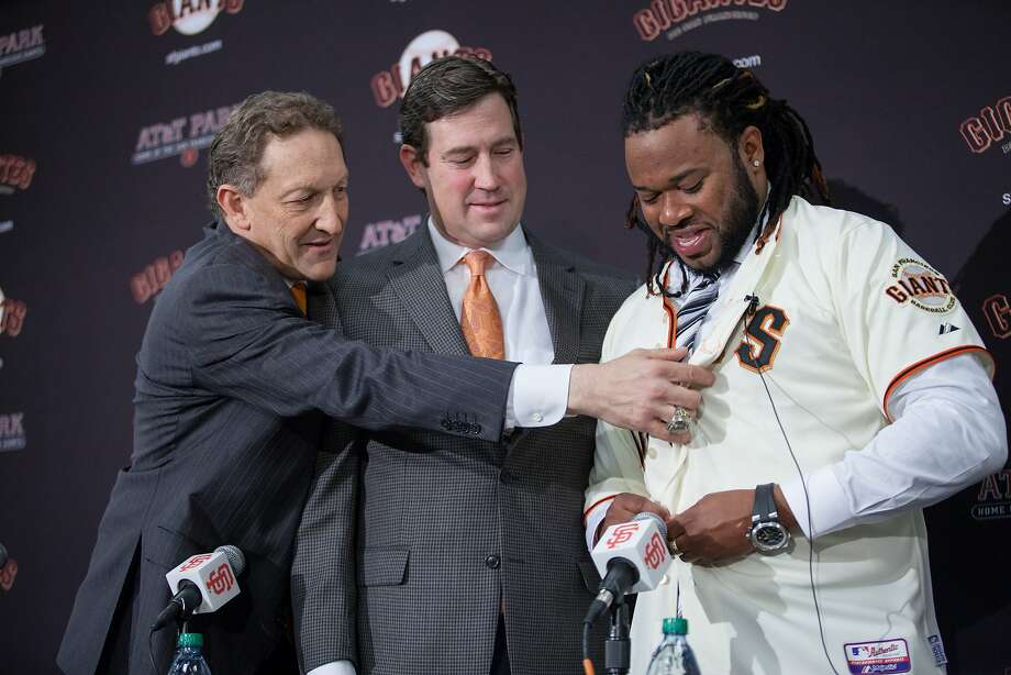 San Francisco Giants CEO Larry Baer and general manager Bobby Evans present Johnny Cueto with his Giants jersey. Photo: Santiago Mejia, Special To The Chronicle