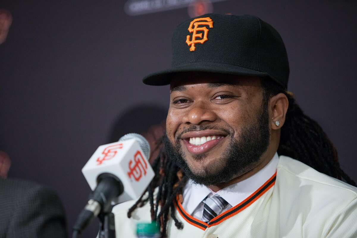 Johnny Cueto laughs during a news conference at AT&T Park, Thursday, Dec. 17, 2015, in San Francisco, Calif. The Giants introduced Johnny Cueto as their new official player today. Cueto, 29, signed a six-year, $130 million contract.
