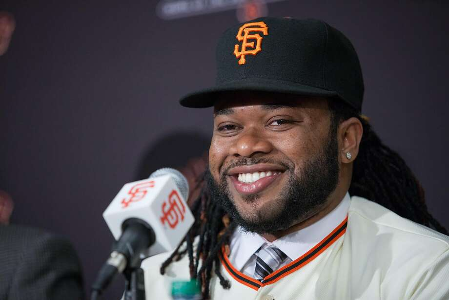 Johnny Cueto laughs during a news conference at AT&T Park, Thursday, Dec. 17, 2015, in San Francisco, Calif. The Giants introduced Johnny Cueto as their new official player today. Cueto, 29, signed a six-year, $130 million contract. Photo: Santiago Mejia, Special To The Chronicle