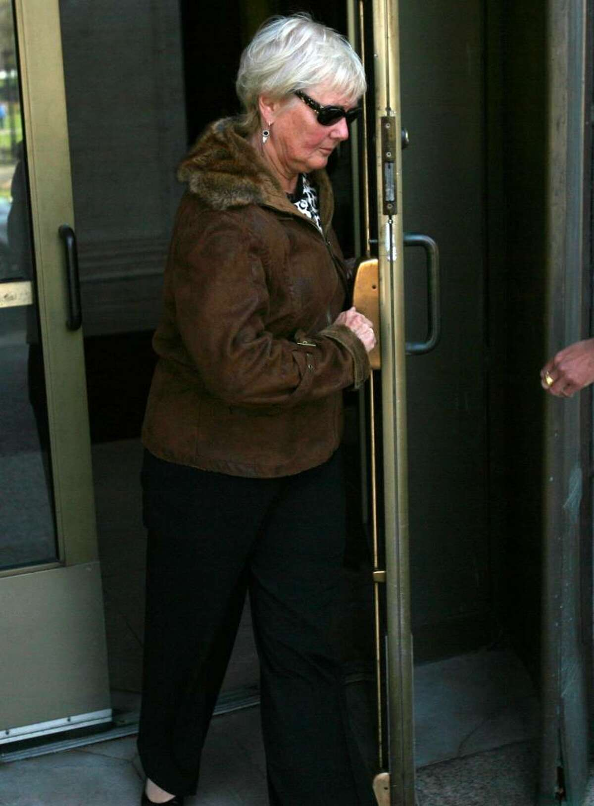 Daniel Perlitz' mother Cheryl Perlitz leaves the federal courthouse in New Haven after attending a hearing in her son's case on Thursday, April 1, 2010.