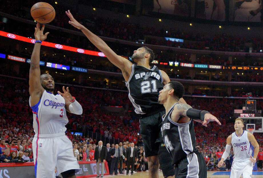 Los Angeles Clippers guard Chris Paul shoots with a second left as Spurs forward Tim Duncan defends in Game 7 of a first-round playoff series in 2015. Photo: Mark J. Terrill /Associated Press / AP