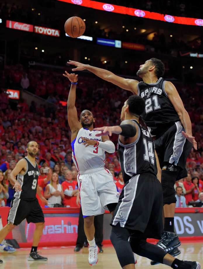 Clippers guard Chris Paul shoots over Spurs forward Tim Duncan (21) during the final seconds of Game 7 in a Western Conference first-round playoff series on May 2, 2015, in Los Angeles. Photo: Mark J. Terrill /Associated Press / AP
