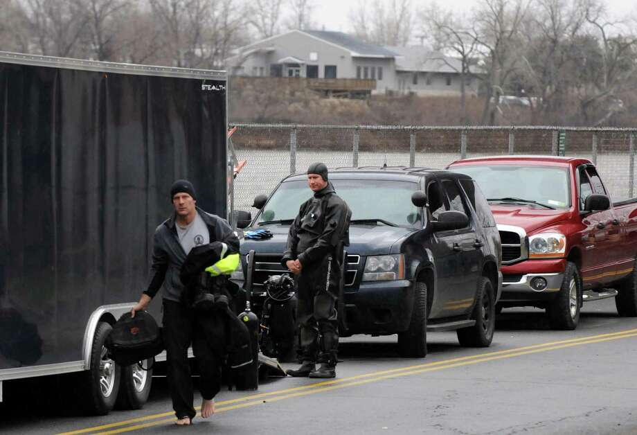 State police divers continue the search for Noel Alkaramla in the Hudson River, below the John P. Taylor Apartments, on Thursday Dec. 17, 2015 in Troy, N.Y.  (Michael P. Farrell/Times Union) Photo: Michael P. Farrell / 10034709A