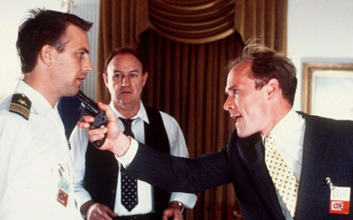 """L-R: Kevin Costner, Gene Hackman, and Will Patton in a tense scene from """"No Way Out"""" (1987). Photo: Courtesy of Shout Factory"""