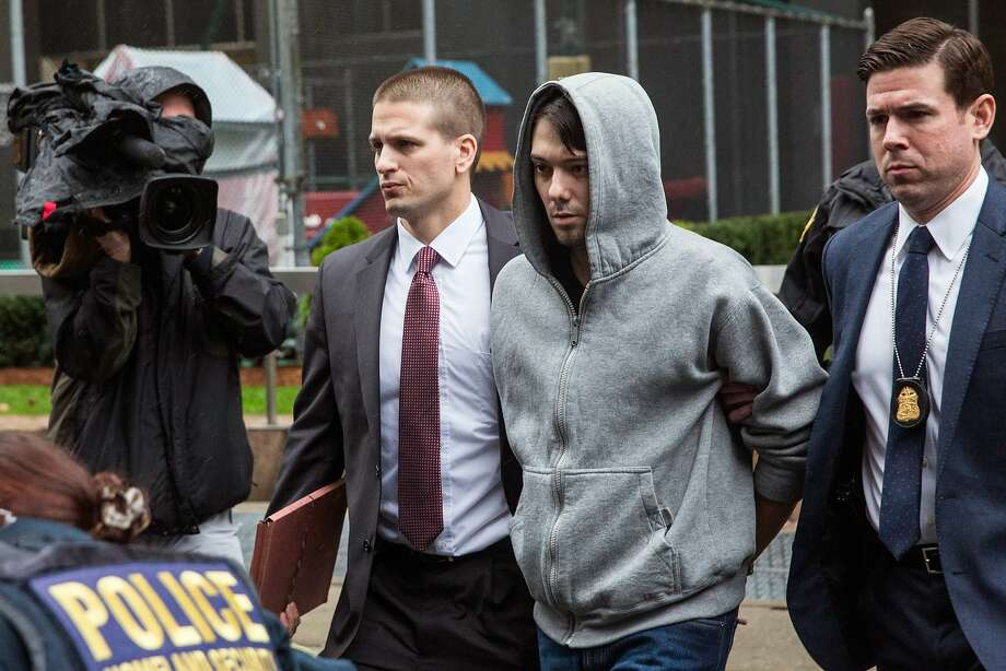 Martin Shkreli (second right), CEO of Turing Pharmaceutical, is arrested for securities fraud on December 17, 2015 in New York City, and his apparel signals the death knell for hoodies as a style marker for the tech set. Shkreli gained notoriety earlier this year for raising the price of Daraprim, a medicine used to treat the parasitic condition of toxoplasmosis, from $13.50 to $750. The arrest did not involve that price hike.  (Photo by Andrew Burton/Getty Images) Photo: Andrew Burton, Getty Images