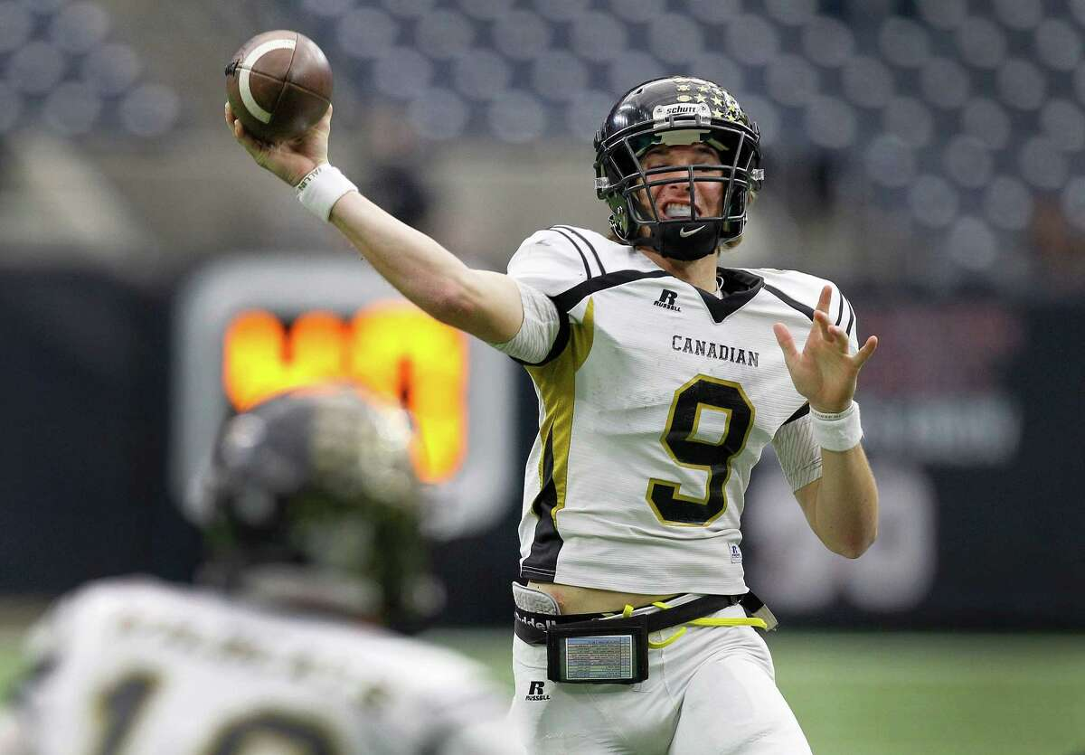 Canadian #9 throws to the end zone in the fourth quarter Thursday, Dec. 17, 2015, in Houston. Canadian defeated Refugio at NRG Stadium in the 2015 Texas High School Football Class 2A Division I Championship Game.