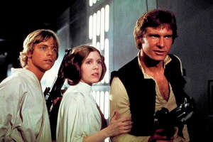 "This photo provided by Twentieth Century Fox Home Entertainment shows, Mark Hamill, from left, as Luke Skywalker, Carrie Fisher as Princess Leia Organa, and Harrison Ford as Hans Solo in the original 1977 ""Star Wars: Episode IV - A New Hope"" film, included in the new Blu-ray release of  ""Star Wars: The Complete Saga"" out on Oct. 13, 2015. The new film, ""Star Wars: The Force Awakens,"" opens in U.S. theaters on Dec. 18, 2015. (Twentieth Century Fox Home Entertainment via AP) ORG XMIT: CAET453"