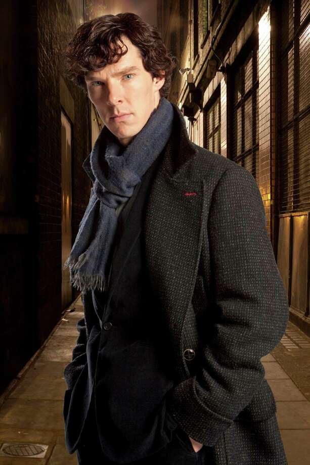 """FILE - In this undated file publicity image released by PBS,  Benedict Cumberbatch portrays Sherlock Holmes in """"Sherlock."""" Cumberbatch was nominated for an Emmy Award for best actor in a miniseries or movie for """"Sherlock: His Last Vow,"""" on Thursday, July 10, 2014. The 66th Primetime Emmy Awards will be presented Aug. 25 at the Nokia Theatre in Los Angeles. (AP Photo/PBS, File) ORG XMIT: NYET419 / PBS"""