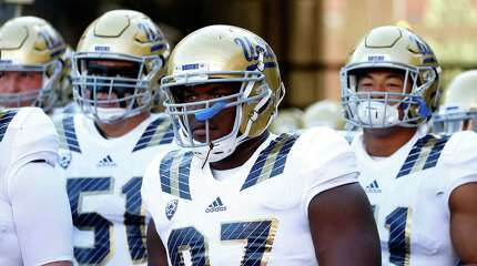 TUCSON, AZ - SEPTEMBER 26:  Defensive lineman Kenny Clark #97 of the UCLA Bruins prepares to take the field before the college football game against the Arizona Wildcats at Arizona Stadium on September 26, 2015 in Tucson, Arizona.