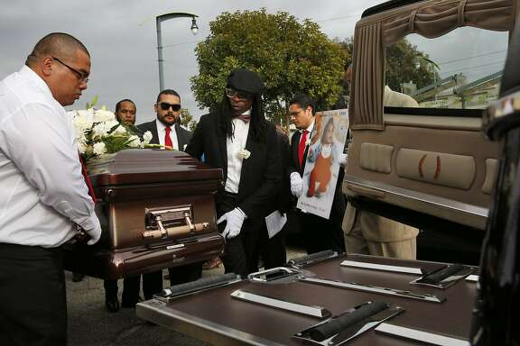 Pallbearers load the coffin of Mario Woods into a hearse after the funeral service for Woods at Cornerstone  Missionary Baptist Church Dec. 17, 2015 in San Francisco, Calif. Mario Woods was fatally shot by San Francisco police in early December.