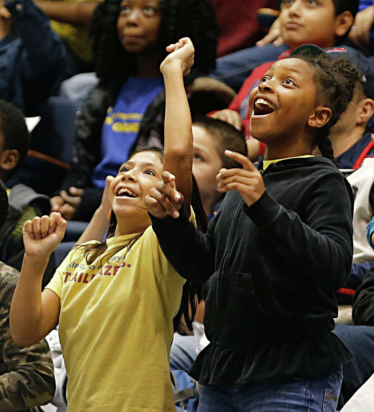 Houston Independent School District students during a field trip to the Rice University and University of St. Thomas men's college basketball game at Tudor Fieldhouse Thursday, Dec. 17, 2015, in Houston.
