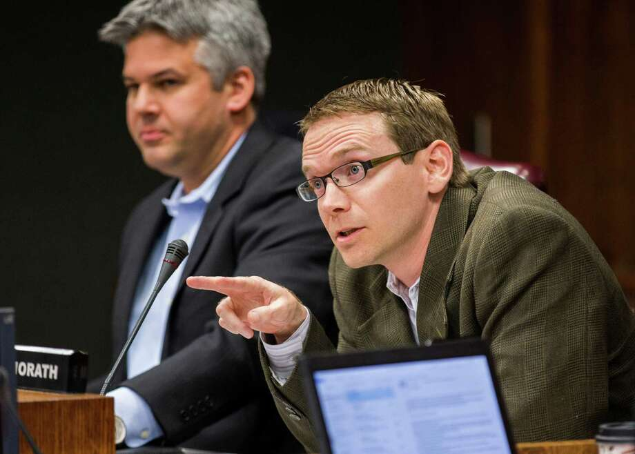 DISD Trustee District 2 Mike Morath, right, asks a question to attorneys before the DISD board of trustees meets in closed session on Monday, February 16, 2015 at DISD Headquarters in Dallas, Texas.  At left is DISD Trustee District 7 Eric Cowan. (Ashley Landis/The Dallas Morning News) Photo: Ashley Landis, THE DALLAS MORNING NEWS / The Dallas Morning News