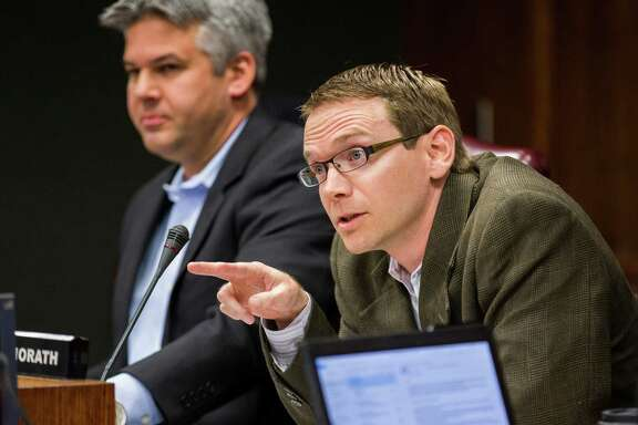 DISD Trustee District 2 Mike Morath, right, asks a question to attorneys before the DISD board of trustees meets in closed session on Monday, February 16, 2015 at DISD Headquarters in Dallas, Texas.  At left is DISD Trustee District 7 Eric Cowan. (Ashley Landis/The Dallas Morning News)