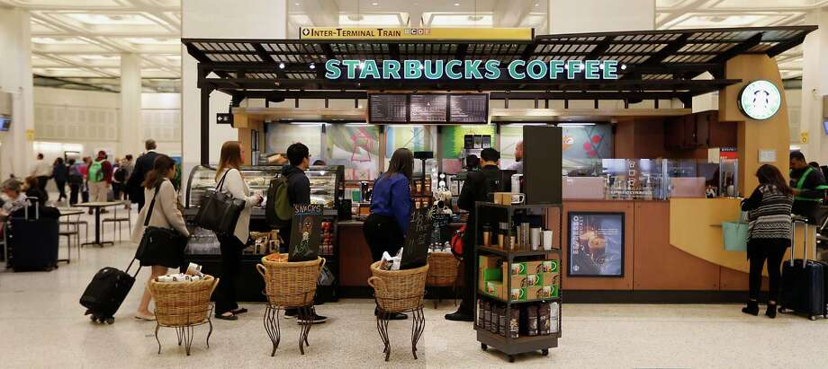 Customers line up at a Bush Intercontinental Starbucks. The company says 1 in 6 American adults received its gift cards over the holidays. Photo: James Nielsen, Staff / © 2015  Houston Chronicle