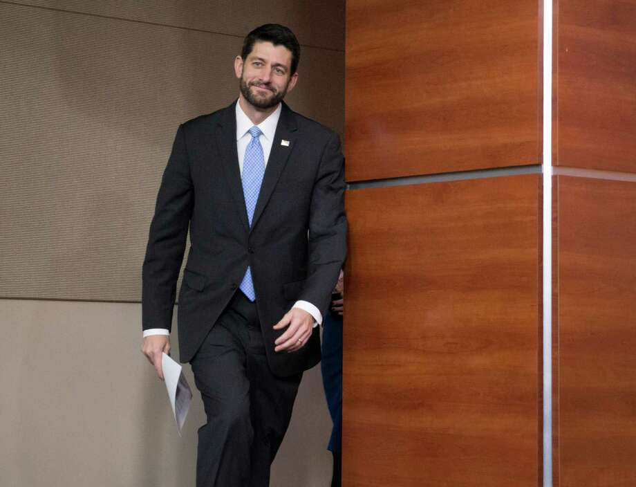House Speaker Paul Ryan of Wis. arrives for an end-of-the-year press conference as the Congress moves toward passage of a $1.1 trillion omnibus spending bill, on Capitol Hill in Washington, Thursday, Dec. 17, 2015. Ryan took over in October from embattled former Speaker John Boehner, R-Ohio.  (AP Photo/J. Scott Applewhite) Photo: J. Scott Applewhite, STF / Associated Press / AP