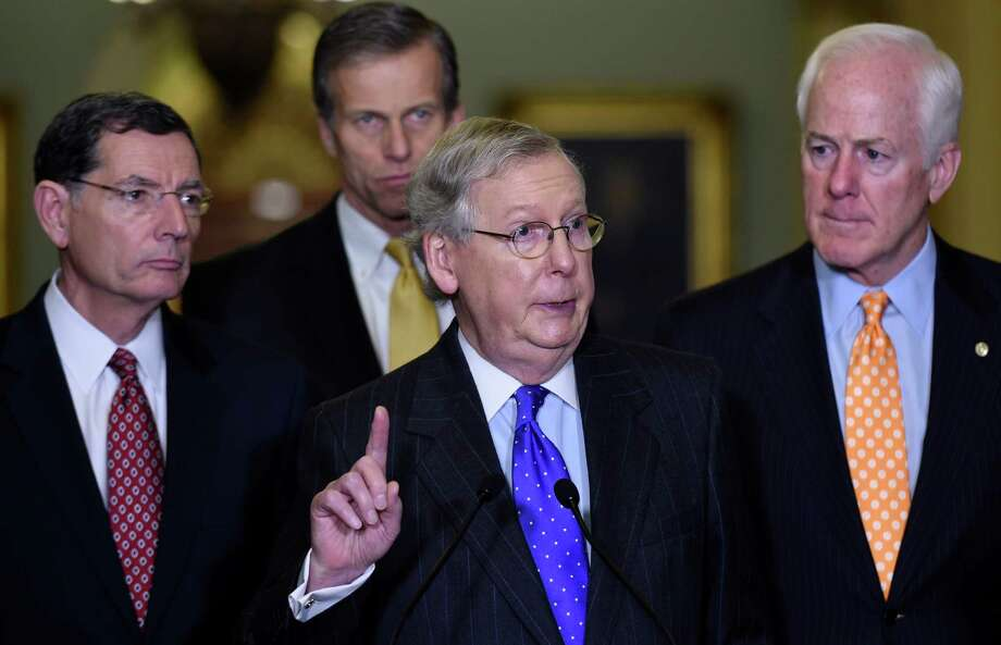 Senate Majority Leader Mitch McConnell of Ky., center, accompanied by, from left, Sen. John Barrasso, R-Wyo., Sen. John Thune, R-S.D., and Senate Majority Whip John Cornyn of Texas, speaks during a news  conference on Capitol Hill in Washington, Tuesday, Dec. 15, 2015, to discuss budget negotiations. (AP Photo/Susan Walsh) Photo: Susan Walsh, STF / Associated Press / AP