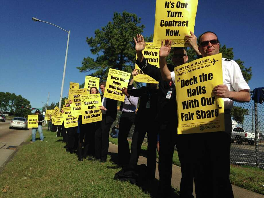 United flight attendant Jason Boussard and others protest on Thursday near Bush Intercontinental Airport.