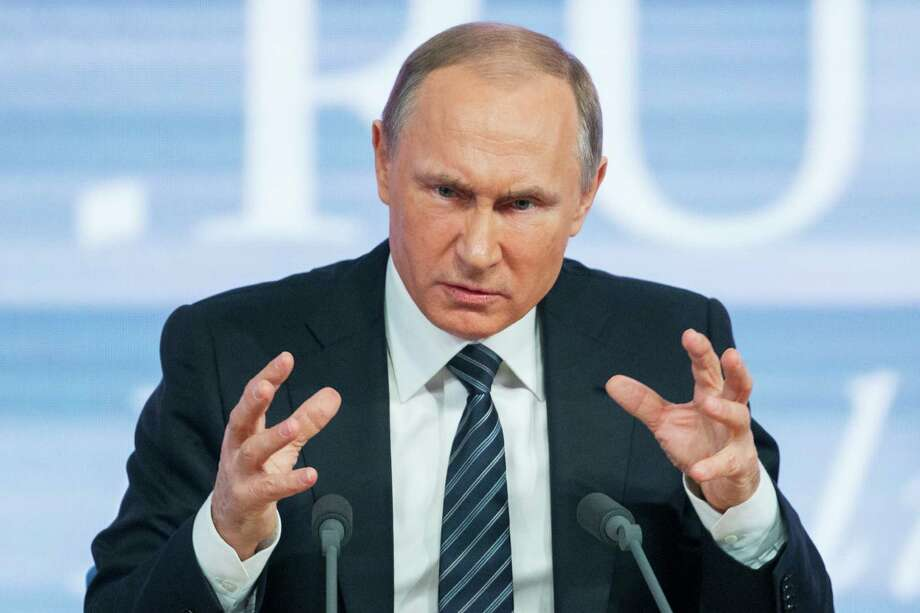 Russian President Vladimir Putin gestures during his annual news conference in Moscow, Russia, Thursday, Dec. 17, 2015. President Vladimir Putin says Turkey acted contrary to its own interests by downing a Russian warplane. Speaking at a televised news conference Thursday, Putin said that he sees no possibility of overcoming the diplomatic strain under the current Turkish leadership. (AP Photo/Alexander Zemlianichenko) Photo: Alexander Zemlianichenko, STF / AP