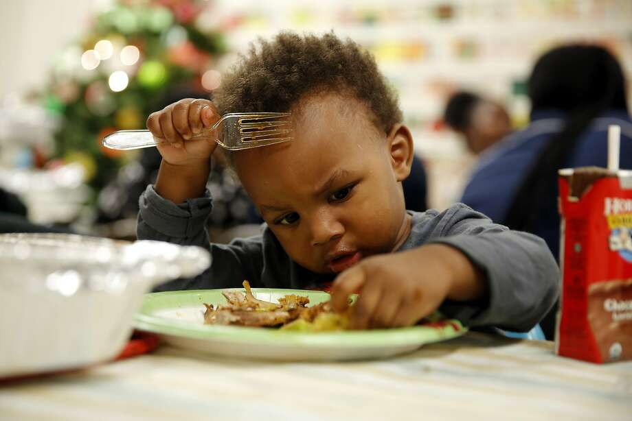 Javon inspects his plate during dinner in a San Francisco Housing Authority building in the Potrero Hill neighborhood of San Francisco, California, on Wednesday, Dec. 16, 2015. Photo: Connor Radnovich, The Chronicle