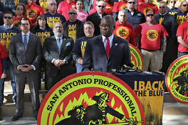 Chistopher Steele, President of the San Antonio Professional Firefighters Association speaks during a press conference on the steps of City Hall announcing his group's support of the San Antonio Police Officers Association as members of both groups gathered together on Thursday, December 17, 2015.
