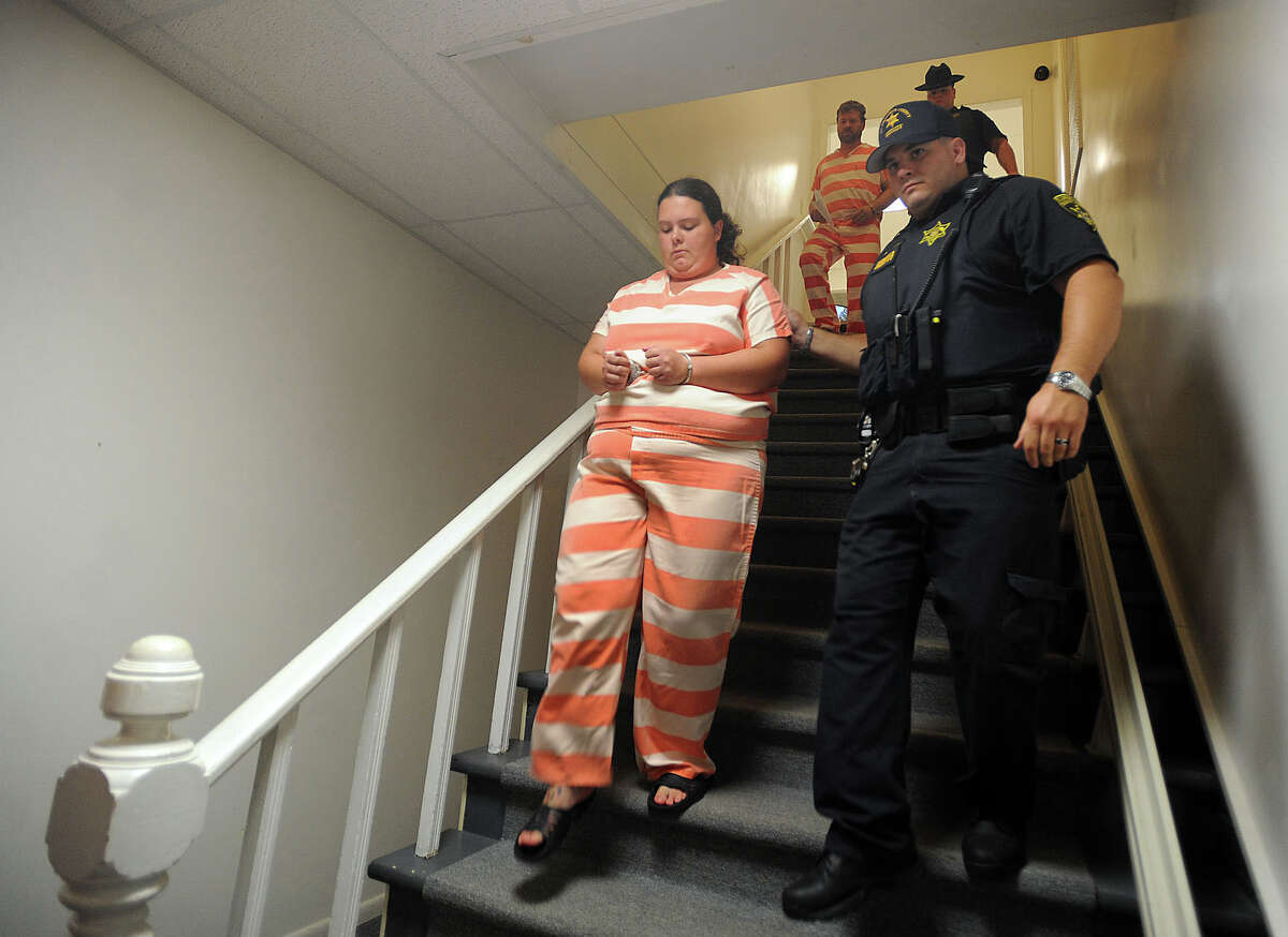 FILE - In this Aug. 15, 2014, file photo, deputies from the St. Lawrence County Sheriff?'s Department escort Nicole Vaisey, left, and Stephen Howells, to their arraignment on first-degree kidnapping charges at Fowler Town Court in Fowler, N.Y. The couple who kidnapped two Amish girls from a farmstand in northern New York and sexually exploited them and other children face sentencing in federal court on Thursday, Dec. 17, 2015. (Melanie Kimbler-Lago/The Watertown Daily Times via AP, File) SYRACUSE OUT ORG XMIT: NYWAT101
