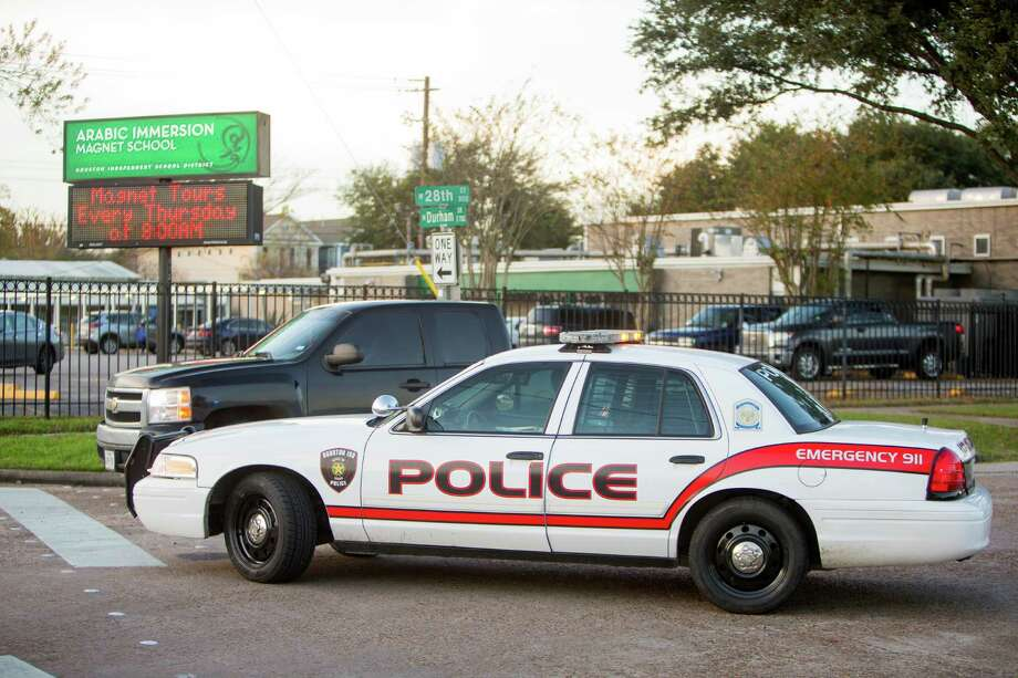 HISD police werepresent at the Arabic Immersion Magnet School on Thursday, in Houston. The Houston Independent School District received an email threatening widespread violence at unnamed campuses on Thursday. Photo: Cody Duty, Staff / © 2015 Houston Chronicle