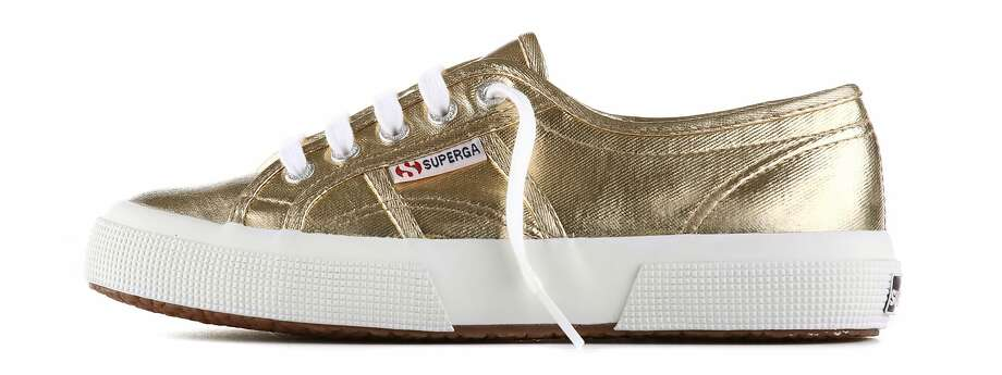Italian sneaker brand Superga came to Fillmore Street this fall, with the opening of a new, stand-alone store run and owned by Claudia Volpi. Seen here are gold metallic sneakers for women. The store carries shoes for men, women and children. Prices range from $45 to $200. Photo: Courtesy Of Superga