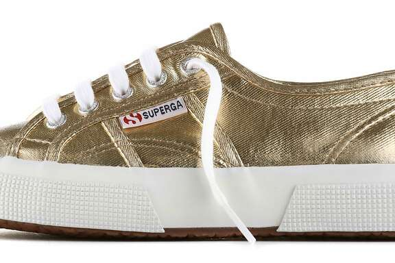 Italian sneaker brand Superga came to Fillmore Street this fall, with the opening of a new, stand-alone store run and owned by Claudia Volpi. Seen here are gold metallic sneakers for women. The store carries shoes for men, women and children. Prices range from $45 to $200.