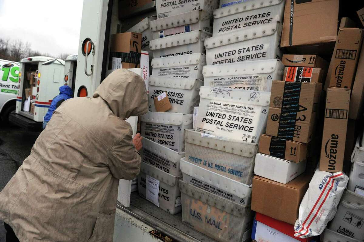 Law enforcement officers, postal employees and volunteers deliver thousands of cards and packages sent to Sa?'Fyre Terry on Thursday Dec. 17, 2015 in Schenectady, N.Y. (Michael P. Farrell/Times Union)
