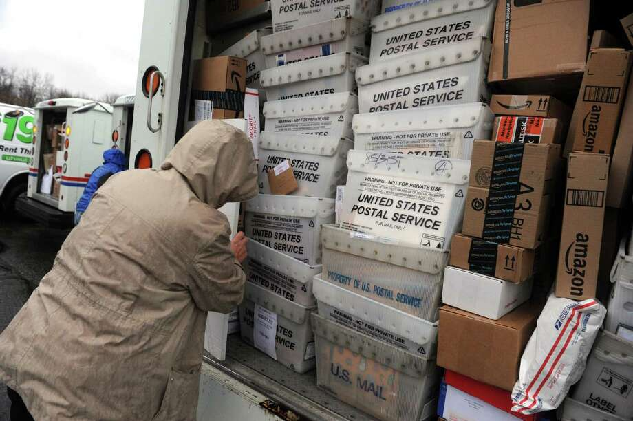 Law enforcement officers, postal employees and volunteers deliver thousands of cards and packages sent to Sa'Fyre Terry  on Thursday Dec. 17, 2015 in Schenectady, N.Y.  (Michael P. Farrell/Times Union) Photo: Michael P. Farrell / 10034698A