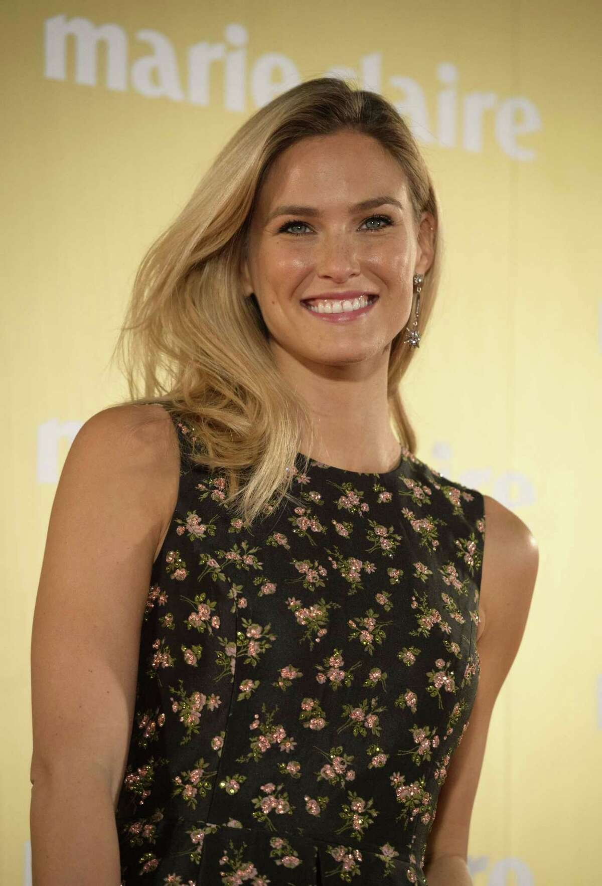 Israeli model Bar Refaeli poses as she arrives for the Marie Claire XII Fashion Prix awards in Madrid on November 19, 2014. AFP PHOTO / DANI POZODANI POZO/AFP/Getty Images