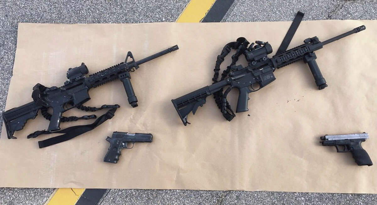 In a photo provided by the San Bernardino County Sheriff's Department, the weapons police say were used in the mass shooting in San Bernardino, Calif., Dec. 3, 2015. Nine days after 14 people were gunned down, investigators are focusing the role played by Enrique Marquez ?- a longtime friend of Syed Rizwan Farook who bought the assault rifles used in the attack. (San Bernardino County Sheriff's Department via The New York Times) -- FOR EDITORIAL USE ONLY -- ORG XMIT: XNYT116