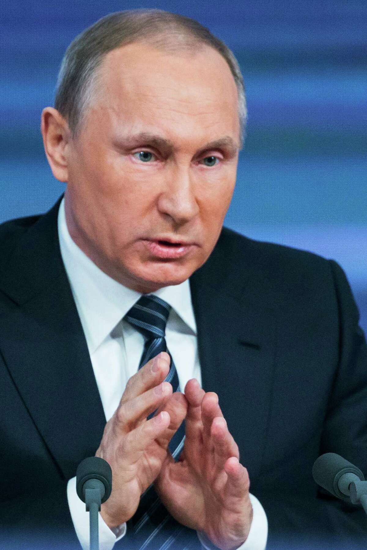 Russian President Vladimir Putin gestures during his annual news conference in Moscow, Russia, Thursday, Dec. 17, 2015. Putin says that Russia's economy is showing signs of stabilization despite plummeting oil prices. Putin, speaking Thursday at a news conference televised live, said that despite a GDP drop caused by a drop in global oil prices, Russia's main commodity, the nation's industries have started to rebound. (AP Photo/Alexander Zemlianichenko) ORG XMIT: XPAG106