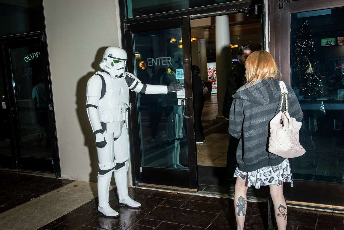 Storm Trooper Chad Fletcher, with 501st, allows a lady to go in the door first during the opening of the new Star Wars: The Force Awakens movie at the Santikos Palladium theater in San Antonio, Texas on Thursday, December 17, 2015.