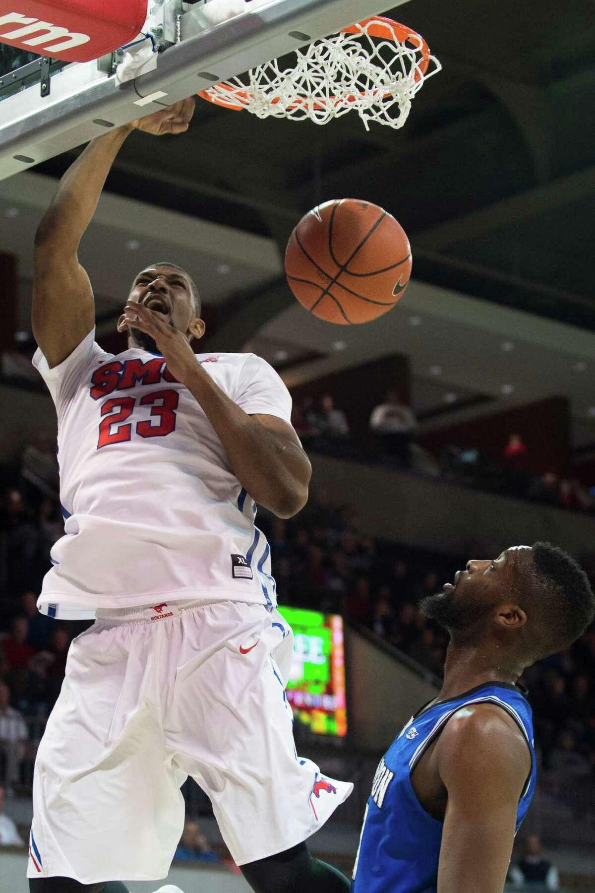 DALLAS, TX - DECEMBER 17: Jordan Tolbert #23 of the SMU Mustangs dunks the ball against the Hampton Pirates on December 17, 2015 at Moody Coliseum in Dallas, Texas. (Photo by Cooper Neill/Getty Images) ORG XMIT: 596457513
