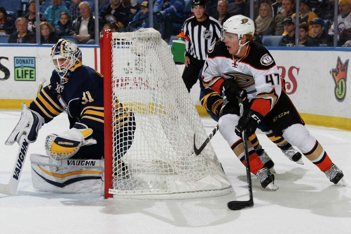 BUFFALO, NY - DECEMBER 17: Hampus Lindholm #47 of the Anaheim Ducks skates with the puck as Chad Johnson #31 of the Buffalo Sabres defends the net at First Niagara Center on December 17, 2015 in Buffalo, New York. (Photo by Jen Fuller/Getty Images) ORG XMIT: 574713333