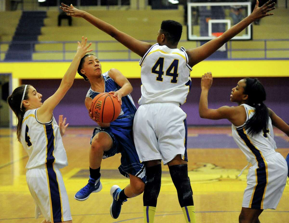 Albany's Ayannna Hunter, center, scores against Troy during the first half of their girls' high school basketball game on Thursday, Dec. 17, 2015, in Troy, N.Y. (Hans Pennink / Special to the Times Union) ORG XMIT: HP105