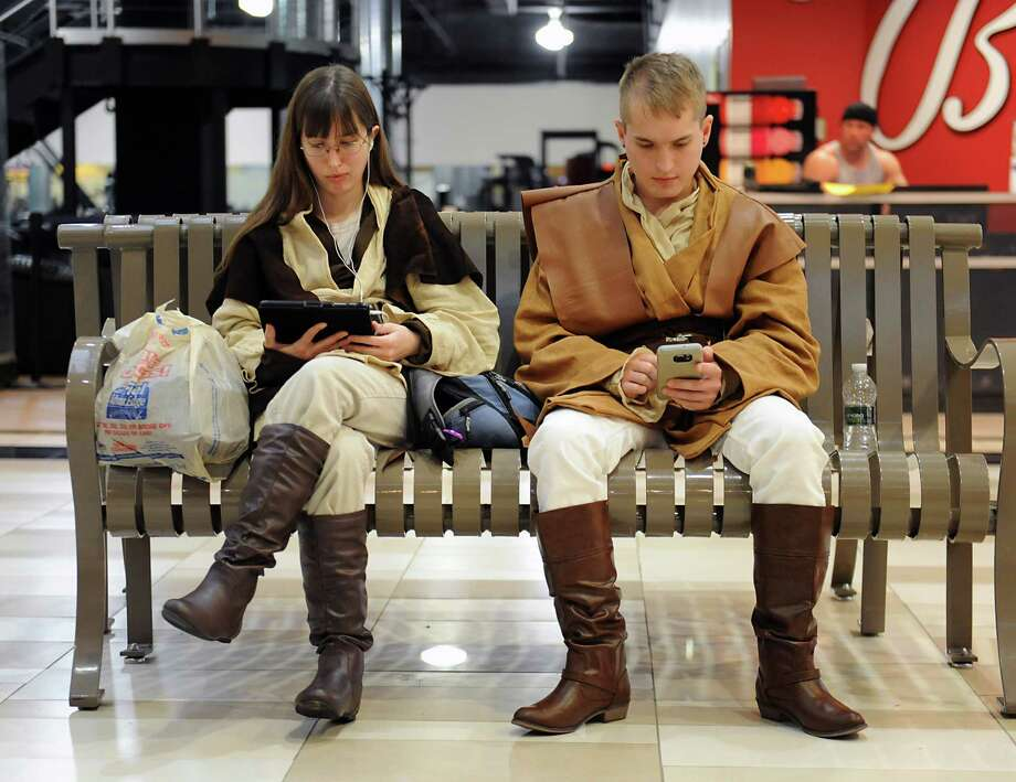 "Kimberly Kunker, 27, and her brother Brendon, 23, of Guilderland are dressed as Jedis while waiting at Crossgates Mall to see the movie ""Star Wars: The Force Awakens"" on Thursday, Dec. 17, 2015 in Guilderland, N.Y. (Lori Van Buren / Times Union) Photo: Lori Van Buren / 10034710A"
