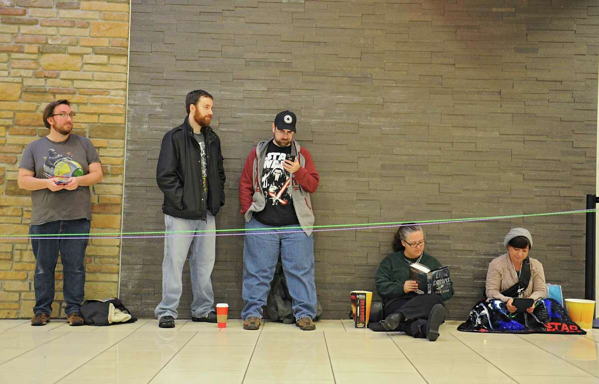 """People wait in a small line to see the 8 o'clock viewing of the movie """"Star Wars: The Force Awakens"""" on Thursday, Dec. 17, 2015 in Clifton Park, N.Y. (Lori Van Buren / Times Union)"""