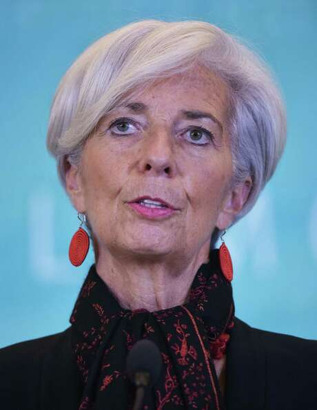 """(FILES) this November 30, 2015 file photo shows International Monetary Fund Managing Director Christine Lagarde as she speaks during a press conference at IMF headquarters in Washington, DC. Christine Lagarde who has been ordered to stand trial in France over her role in a controversial payout of state funds should remain in her post because """"she is presumed innocent,"""" France's finance minister said December 17, 2015. AFP PHOTO/MANDEL NGAN MANDEL NGAN/AFP/Getty Images Photo: MANDEL NGAN, Staff / AFP"""
