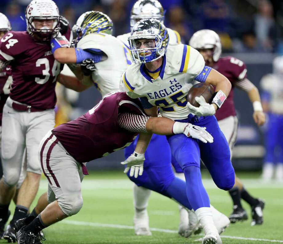 Cameron Yoe's Eddie Luna, left, stops Brock's Leddy French in the first half Thursday night. French ran for 133 yards and three touchdowns. Photo: Gary Coronado, Staff / © 2015 Houston Chronicle