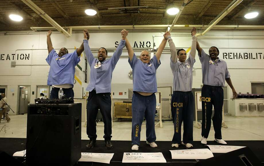 Dana Harper (left), William Palmer, Charles Berberich, Kris Himmelberger and Timothy Johnson celebrate making the list of finalists in Defy Ventures' business-pitch competition for prisoners at Solano State Prison. Photo: Michael Macor, The Chronicle