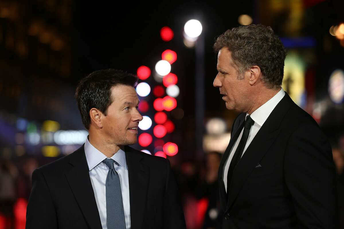 US actors Mark Wahlberg (L) and Will Ferrell (R) talk on the red carpet for the UK premiere of the film 'Daddy's Home' in London on December 9, 2015. AFP PHOTO / JUSTIN TALLISJUSTIN TALLIS/AFP/Getty Images