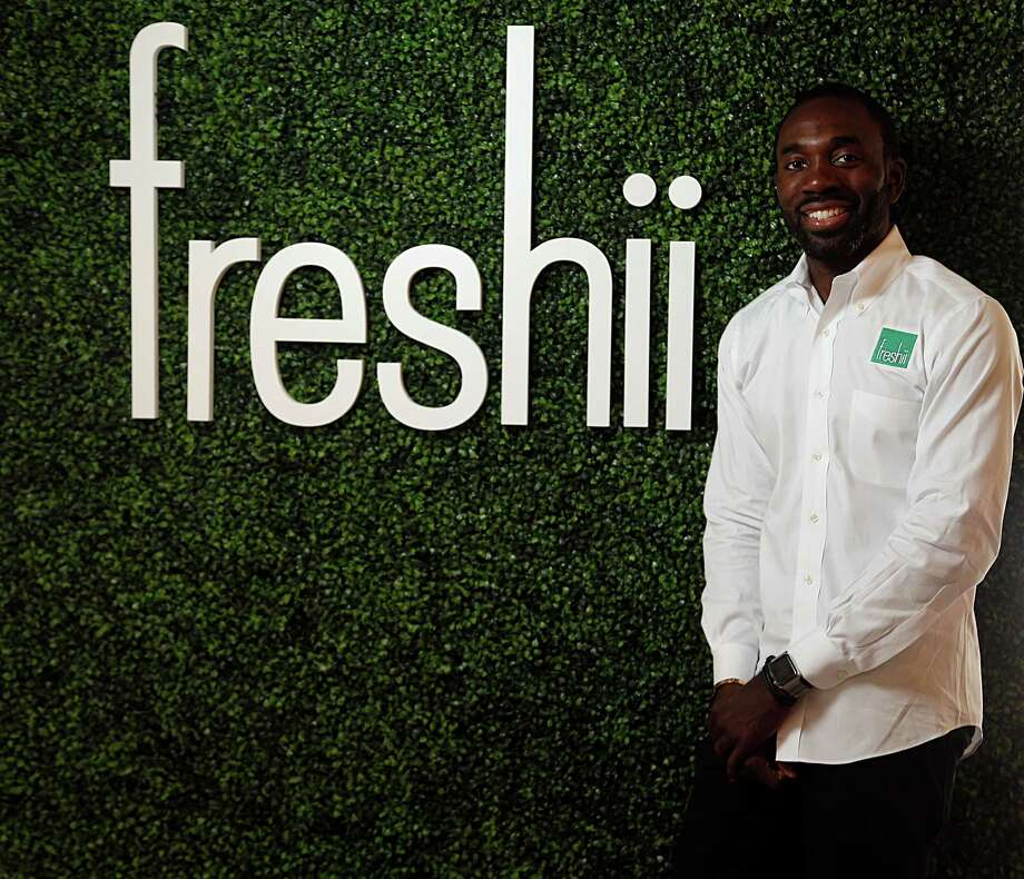 The energy slump left Ade Amos laid off, so he switched directions. He now has two Freshii restaurant locations. Photo: James Nielsen, Staff / © 2015  Houston Chronicle