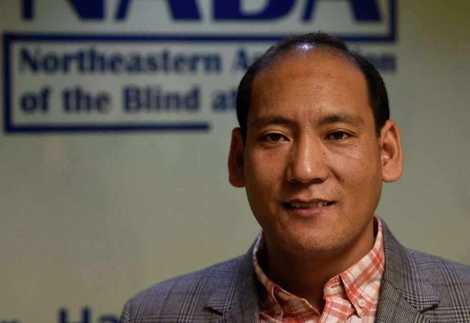 Chhitup Lama from Nepal poses for a photo at the Northeast Association of the Blind Wednesday Dec. 2, 2015 in Albany, N.Y.    (Skip Dickstein/Times Union) Photo: SKIP DICKSTEIN / 10034466A