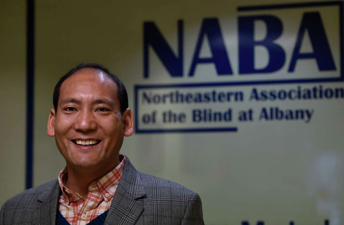 Chhitup Lama from Nepal poses for a photo at the Northeast Association of the Blind Wednesday Dec. 2, 2015 in Albany, N.Y. (Skip Dickstein/Times Union)