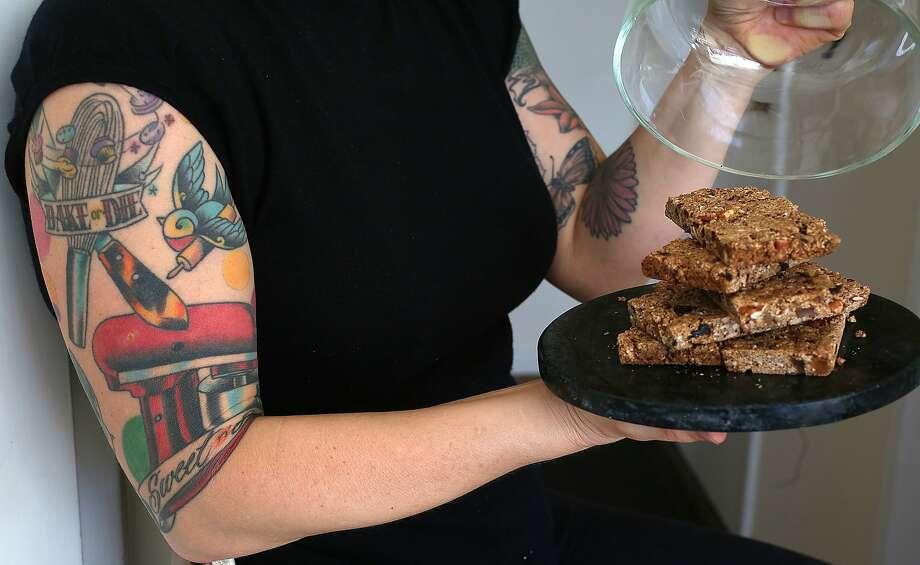 Michelle Pusateri of Nana Joes Granola shows her granola power bars. Photo: Liz Hafalia, The Chronicle