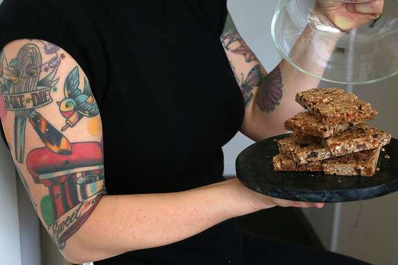 Michelle Pusateri of Nana Joe's Granola shows her granola power bars in San Francisco, California, on Thursday, December 17, 2015.