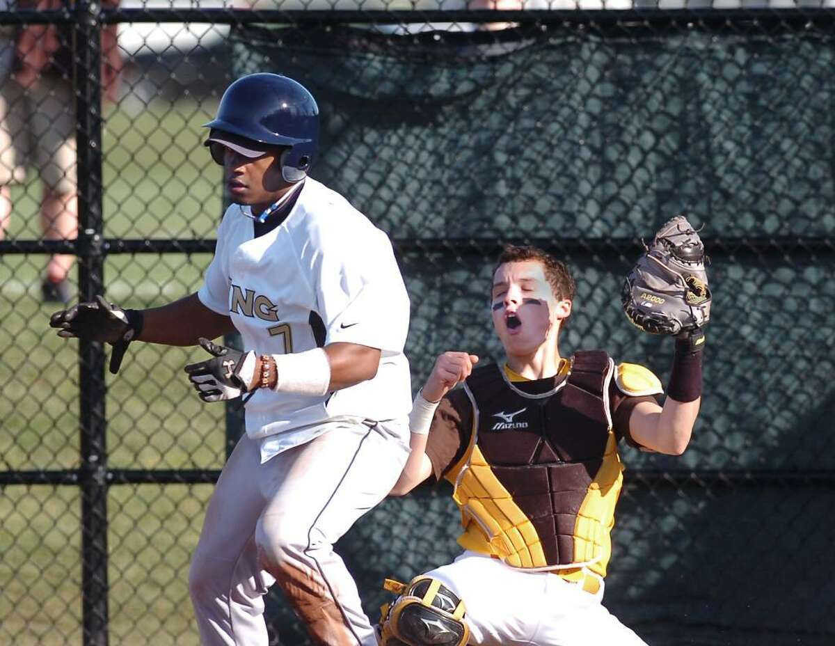 Brunswick catcher, J.P. Bowgen, reacts after King runner Eric Joyner, # 7, left, was called safe at home plate during a play at the plate in the top of the 4th inning, at Brunswick School, Greenwich, Conn., April lst, 2010.