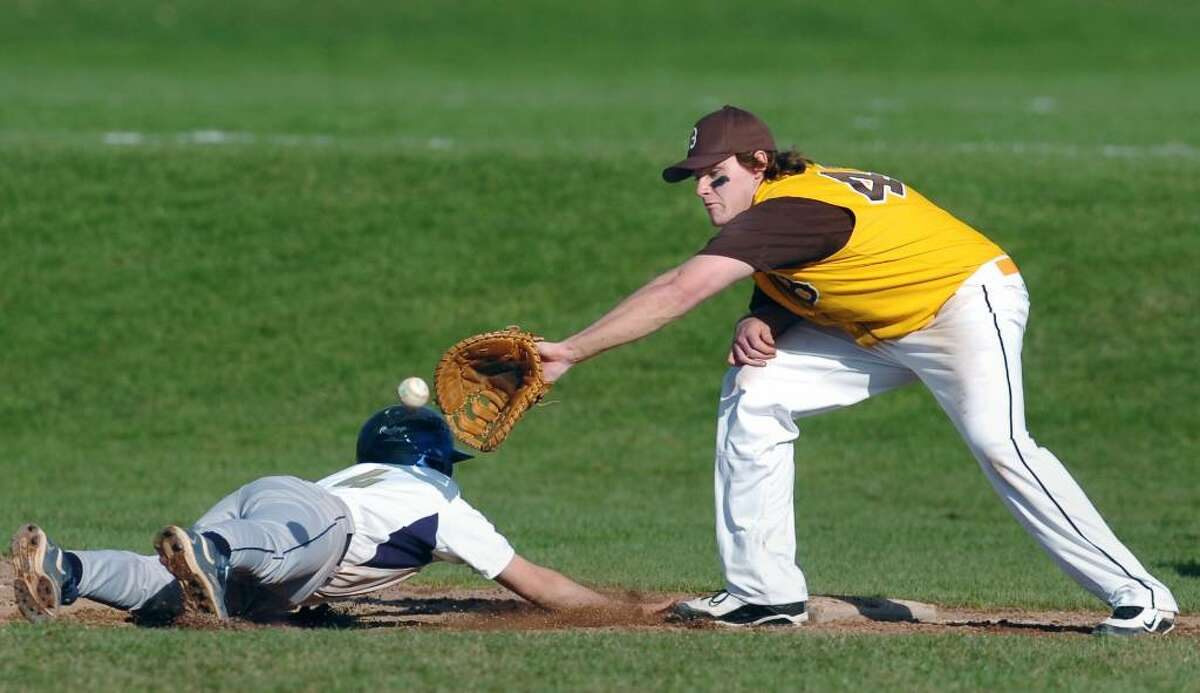 Brunswick first baseman, Ernie Rosato, right, takes the throw on a pick-off attempt as King's R.J. Moavero, # 4, just barely gets safely back to the bag, during the top of the 3rd inning of game between King and Brunswick, at Brunswick School, Greenwich, Conn., April lst, 2010.